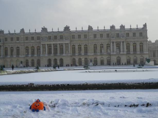 Otto the Orange in front of the Palace of Versailles.