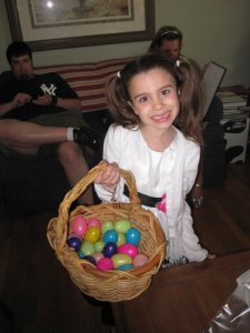 Juliet, my 5-year-old cousin, beating me in the annual Easter egg hunt.